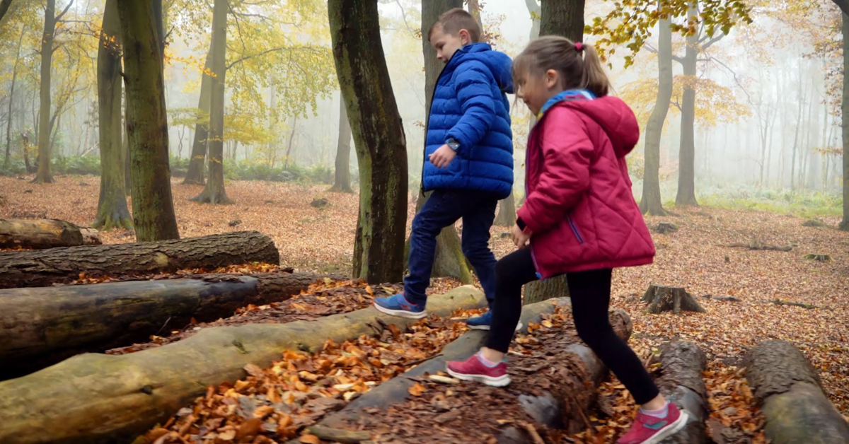 Children walking in the woods wearing the iGPS Wizard Watch